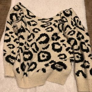 Fuzzy white leopard sweater with twist in back